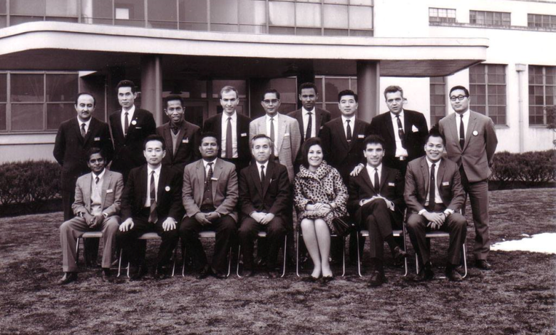 Photo of Artist Ahmed Madoun in front of the Japanese company Fujitsu in 1967