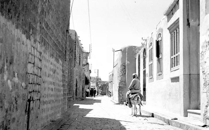 صورة شارع الذهبي – باب هود في حمص في خمسينيات القرن العشرين